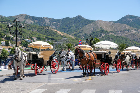 MIJAS, ANDALUCIA/SPAIN - JULY 3 : Horse and Carriage in Mijas Andalucía Spain on July 3, 2017. Unidentified people.