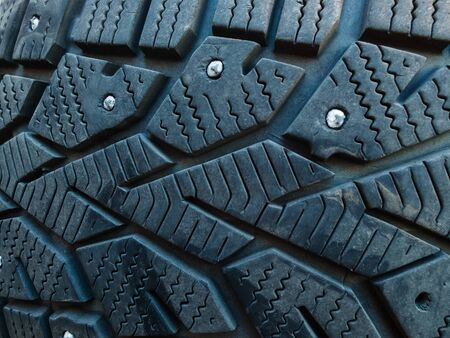 Close-up of winter studded car tyre protector with partly lost studs. Weak gums, losing teeth, periodontosis problems concept