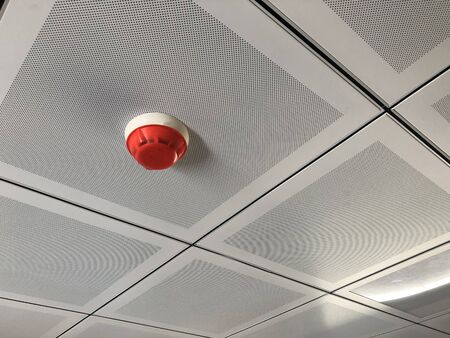 Photo for Fire detector at false ceiling. Fire alarm system - Royalty Free Image