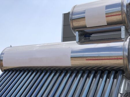 Photo for brand new water tank with solar heating elements - Royalty Free Image