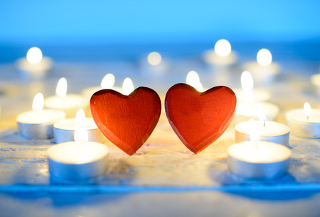 Photo pour small red wooden hearts and candles - image libre de droit
