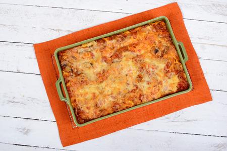 lasagna dish on orange towel