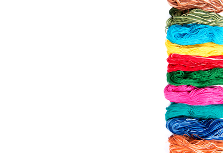 Photo pour embroidery thread skeins of different colors on the white background - image libre de droit