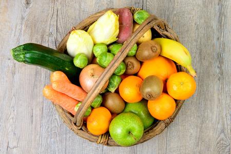 Photo pour fruit and vegetable basket on the wooden table - image libre de droit