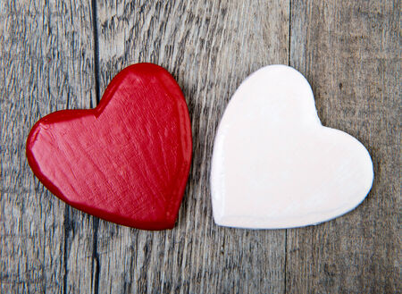 Photo pour two small red and white hearts for valentine day - image libre de droit