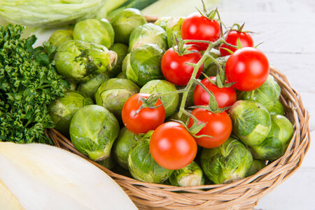 Photo pour small tomatoes and brussels sprouts with parsley - image libre de droit
