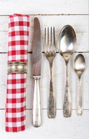 Photo pour antique cutlery and towel on the white wooden table - image libre de droit
