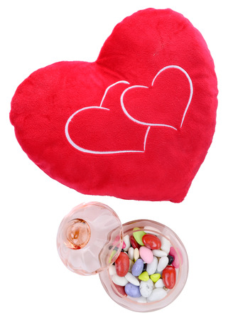 Photo pour heart shaped cushion with candy on the white background - image libre de droit