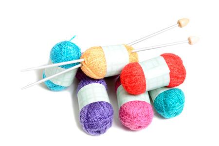 Photo pour small multicolored balls of wool on white - image libre de droit
