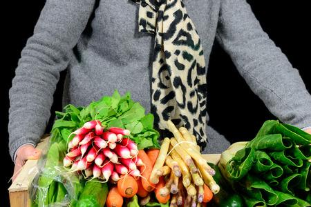Photo pour Small crate with various seasonal vegetables on black  - image libre de droit