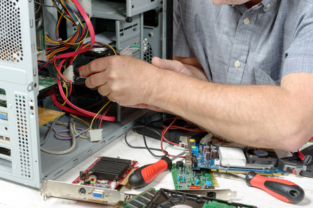 close-up on the hands of the technician repairing a computer