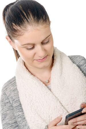 Photo pour A beautiful hispanic girl was texting her cellphone - image libre de droit
