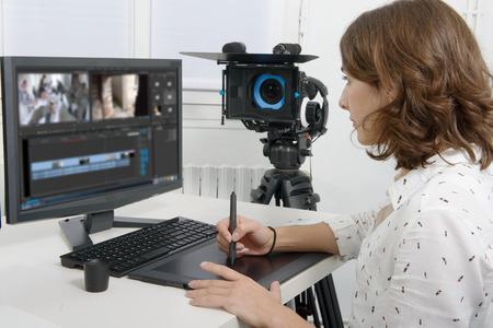 Photo pour young female designer using graphics tablet for video editing - image libre de droit