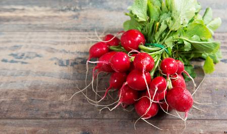 Foto de delicious radishes organic brunch on the rustic wooden  table - Imagen libre de derechos