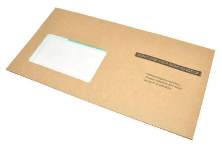 A voter registration form in a brown envelope with don't loose your right to vote printed on it, isolated on a white background