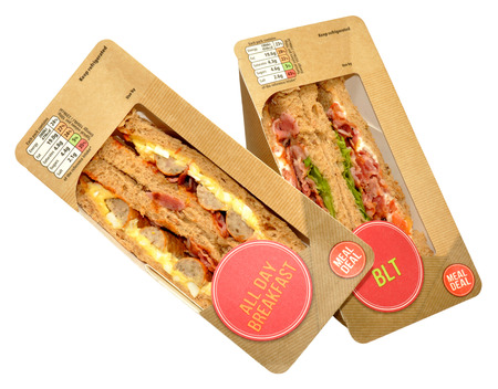 Two packs of freshly made shop bought sandwiches, isolated on a white background.