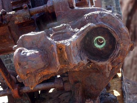 Foto de Close up of a large rusting broken industrial engine with bolts and gears outdoors - Imagen libre de derechos