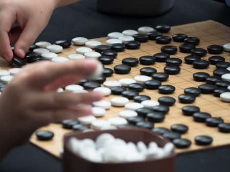 Photo pour Go game board game that requires cunning to defeat competitors. - image libre de droit