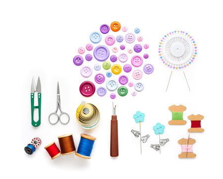 Photo pour Overhead view of sewing tools and accessories on white background - image libre de droit