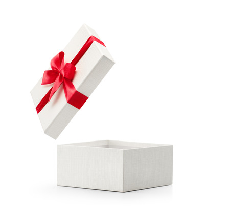Foto de White gift box with red bow isolated on white background - Clipping path included - Imagen libre de derechos