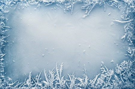 Foto de Frost crystal border on ice - Christmas background - Imagen libre de derechos