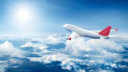 Photo pour Airplane flying above clouds - image libre de droit
