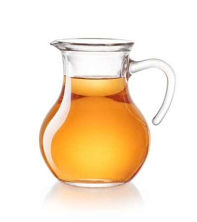 Photo for Apple juice in a pitcher isolated on white - Royalty Free Image