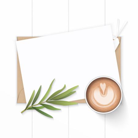 Foto de Flat lay top view elegant white composition paper, kraft envelope, tarragon leaf tag and coffee on wooden background. - Imagen libre de derechos