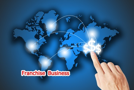 The hand pressing on the financial button franchise business