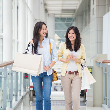 Happy young Asian women shopping.の写真素材