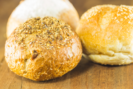 the fresh bread  on the wood background, warm toning, selective focus