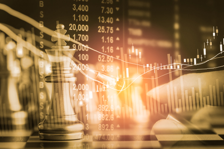 Photo pour Business game on digital stock market financial and chess background. Digital business and stock market financial on LED. Double exposure chess business strategy and digital stock market financial. - image libre de droit