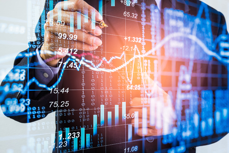 Foto de Business man on stock market financial trade indicator background. Man analysis stock market financial trade indices on LED. Double exposure of business man trade on stock market financial concept. - Imagen libre de derechos