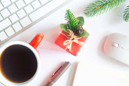 Photo pour White Christmas, desk office with laptop, decoration and work supplies with cup of coffee. Top view with copy space for input the text. Flat lay desk table winter Christmas. Business Holidays Concept. - image libre de droit