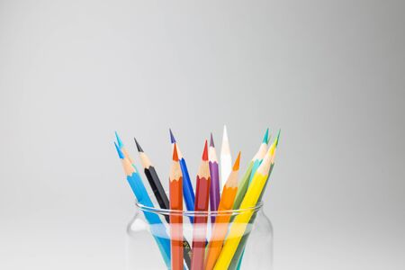 Photo pour Bright pencils in a glass isolated on white background. A banner concept of work from home WFH with copy space for runaround or wraparound text. - image libre de droit