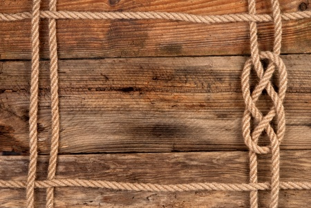 Rope frame on wooden background