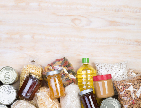 Photo pour Food donations on wooden background, top view with copy space - image libre de droit