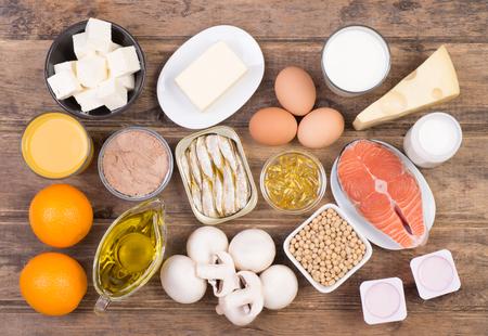 Photo pour Vitamine D food sources, top view on wooden background - image libre de droit