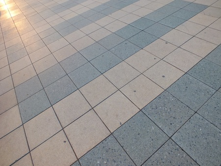 Paved area lit by the evening sun
