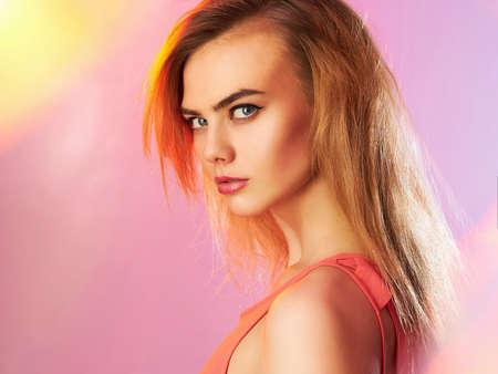 Photo pour Beautiful girl with makeup in colorful lights. beauty fashion portrait - image libre de droit