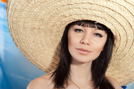 Photo for Brunette girl in a mexican hat - Royalty Free Image