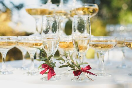 Foto für Beautiful hill with champagne at the Banquet for the newlyweds. Glasses of the bride and groom. - Lizenzfreies Bild