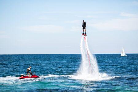 Foto für Silhouette of a fly board rider at sea - Lizenzfreies Bild