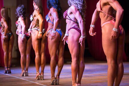 Photo pour Woman to compete in fitness bikini. closeup beautiful female bikini buttocks. - image libre de droit