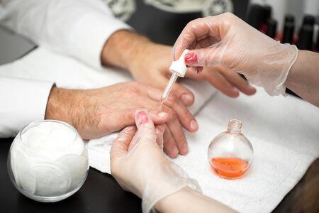 Photo pour Manicure, Hands spa Cuticle oil. Beautiful man hands closeup. Manicured nails. Beauty hands. Beauty treatment - image libre de droit