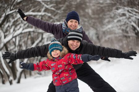 Photo for Family playing in the snow in winter. - Royalty Free Image