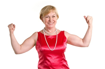 Photo for Portrait of fit senior woman flexing her biceps - Royalty Free Image