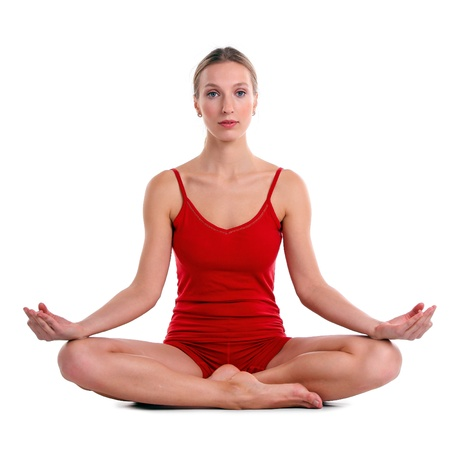 Young woman practicing yoga in the lotus position, isolated over white