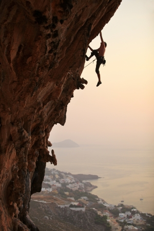 Rock climber at sunset, Kalymnos Island, Greece