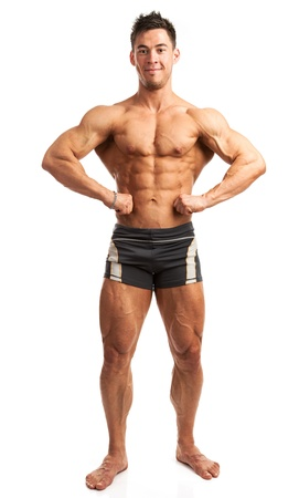 Young bodybuilder posing isolated over white background